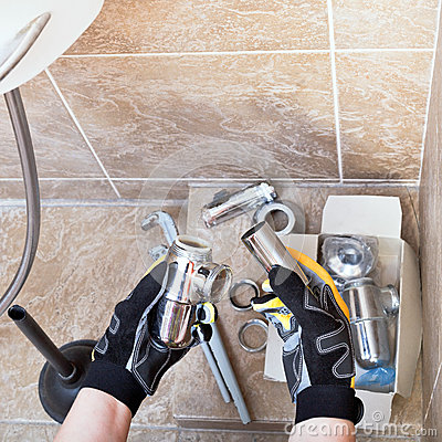 Free Sanitary Technician Repairs Plumbing Trap Stock Photography - 48697282