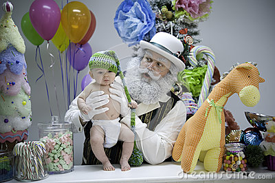 Santa in candy shop with baby