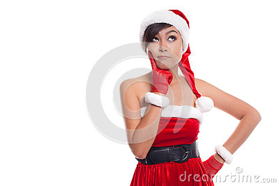 Santa christmas woman looking to the side thinking happy and pla Stock Photo