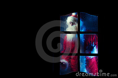 Santa Claus behind the glass door
