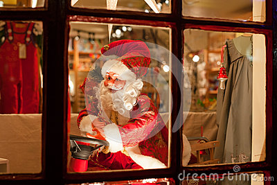 Santa claus behind the window