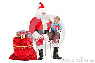 Santa Claus and child with a gift posing
