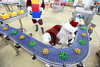 Santa claus at christmas ornament production line