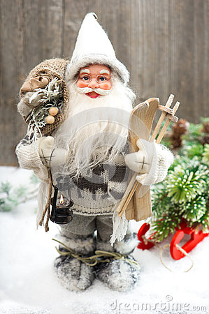 Santa Claus with christmas tree in snow