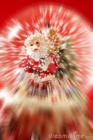 Santa claus figurine on a glass snowing ball
