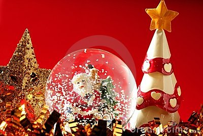 Santa claus figurine on a glass snowing ball