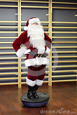 Santa Claus Fitness training on stablity hemisphere