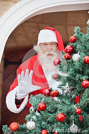 Santa Claus Gesturing From Christmas Tree