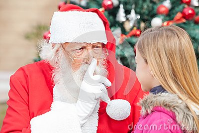 Santa Claus Gesturing Finger On Lips While Looking