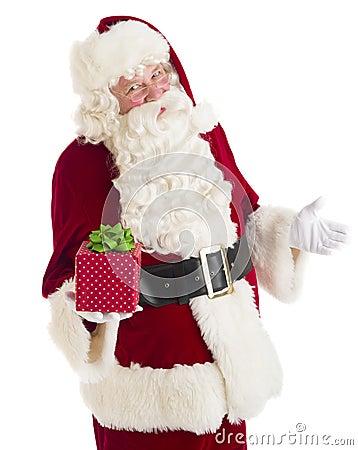 Santa Claus Gesturing While Holding Gift Box