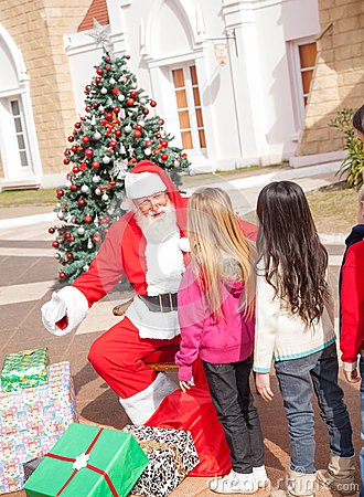 Santa Claus Gesturing While Looking At Girl