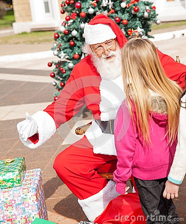 Santa Claus Gesturing While Looking At Girl