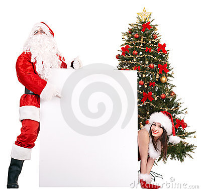 Santa claus and girl with banner by christmas tree