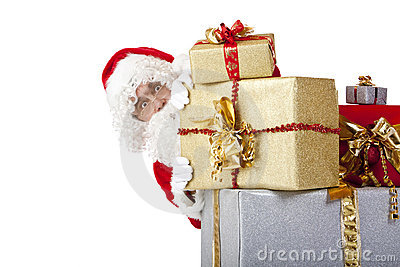 Santa Claus hiding behind christmas gift boxes