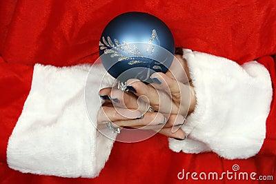 Santa claus hiding a blue ball