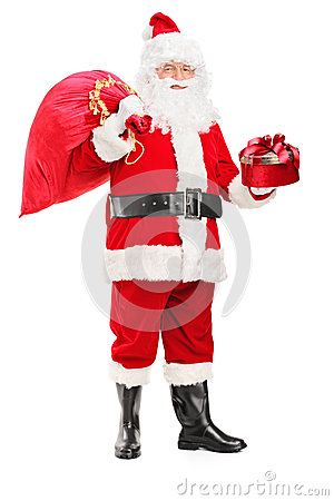 Santa Claus holding a bag and gift