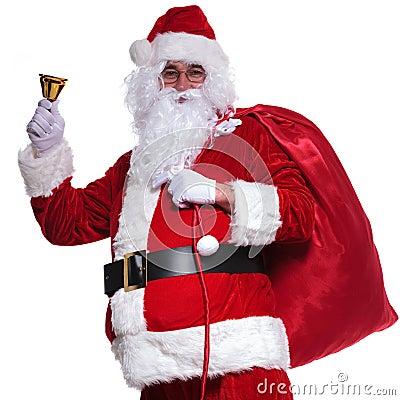 Santa claus holding  bag on shoulder is ringing  bell