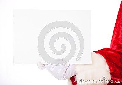 Santa Claus holding white sign