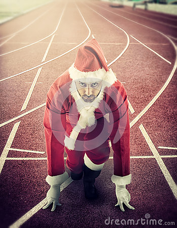 Free Santa Claus In The Starting Position On A Running Track Royalty Free Stock Images - 35185169