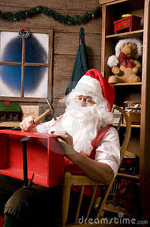 Free Santa Claus In Workshop With Wagon Royalty Free Stock Images - 10907459