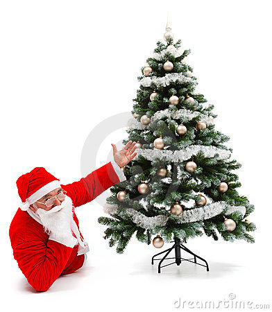 Santa Claus laying and showing christmas tree