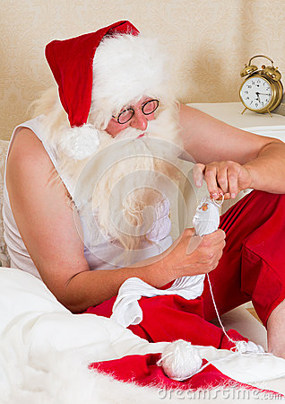 Santa Claus mending his socks