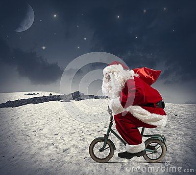 Free Santa Claus On The Bike Royalty Free Stock Photography - 34037107