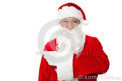 Santa claus pointing away over white