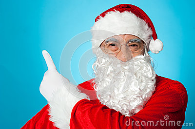 Santa claus pointing away