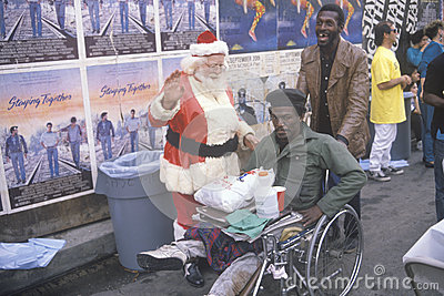Santa Claus posing with homeless men Editorial Stock Image
