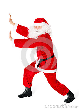 Santa Claus pushing something isolated on white