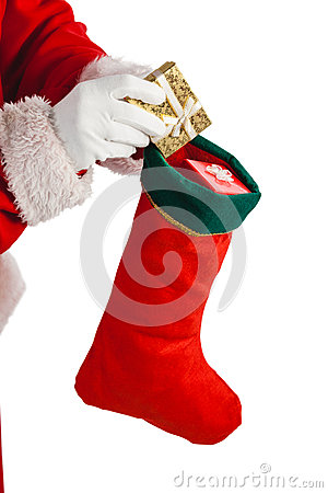 Free Santa Claus Putting Presents In Christmas Stockings Royalty Free Stock Image - 80254056