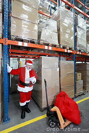 Santa claus reading wishing list of presents in st
