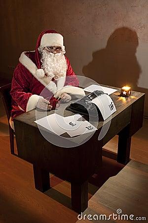 Santa Claus sitting by a desk