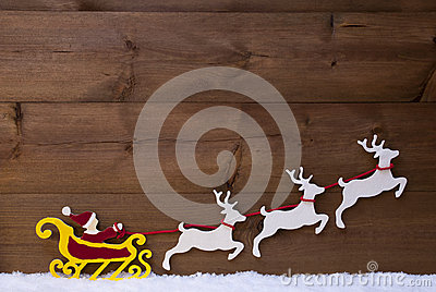 Santa Claus Sled With Reindeer, Snow Stock Photo