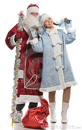 Santa Claus and snow maiden dancing