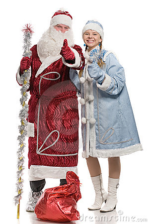 Santa Claus and snow maiden giving thumbs-up sign