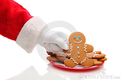 Santa Claus Taking Ginger Bread Man From Plate