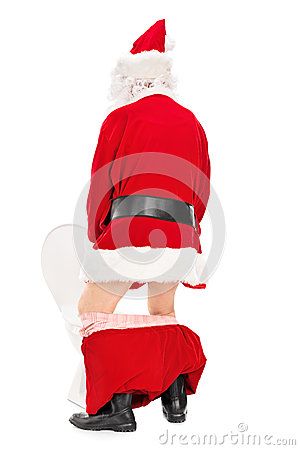 Santa Claus taking a piss in a toilet
