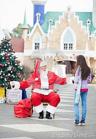 Santa Claus About To Embrace Girl