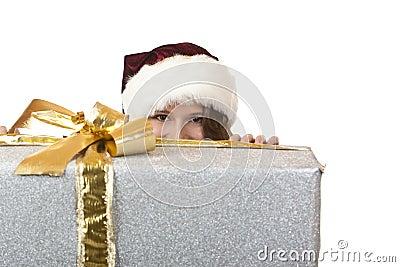 Santa Claus Woman is hiding behind Christmas gift