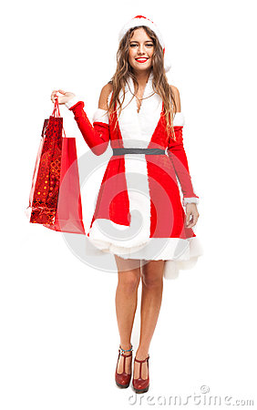 Creative Woman Wearing Santa Claus Costume Holding Shopping Bags