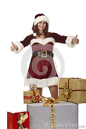 Santa Claus woman presenting Christmas gift boxes