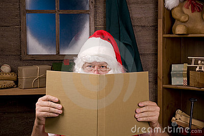Santa Claus in Workshop With Large Book
