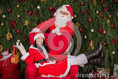 Santa Clause woman sitting on Christmas armchair