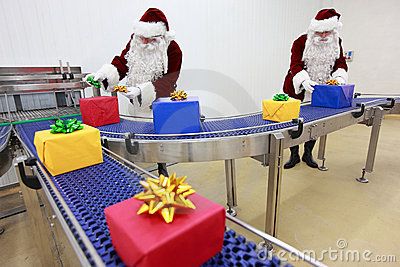 santa clauses working at present production line