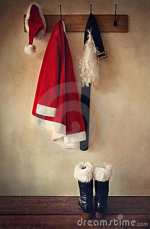 Free Santa Costume With Boots On Coatrack Stock Images - 22109574