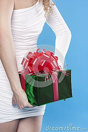 Santa girl hiding a present