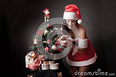 Santa girl open the gift.