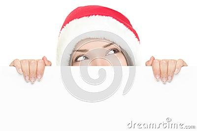 Santa girl peeking over sign board